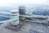 Bitts and mooring lines — Stock Photo