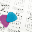 Guitar picks on a chords chart - Stock Photo
