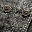 Metal buttons on black leather clothing — Stock Photo