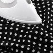 Ironing delicate silky fabric — Stock Photo #21985089