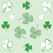 Paintbrush and hand-drawn shamrocks - Stock Vector