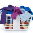 Colorful clothes in laundry basket. Blue, indigo, purple. - Stock Photo