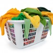 Bright clothes in laundry basket. Green, yellow. — Stock Photo