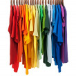 Colors of rainbow, shirts on wooden hangers — Stock Photo