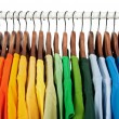Rainbow colors, clothes on wooden hangers — Стоковая фотография