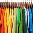 Colors of rainbow, clothes on wooden hangers — Stock Photo #22198093