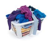 Bright clothes in laundry basket. Blue, indigo, purple. — Stock Photo