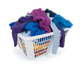 Bright clothes in laundry basket. Blue, indigo, purple. — Stock Photo