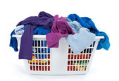 Colorful clothes in laundry basket. Blue, indigo, purple. — Stockfoto