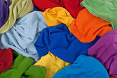 Messy colorful clothes background — Stock Photo