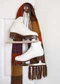 Figure skates and colourful scarf — Stock Photo