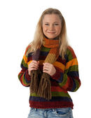Smiling young woman wearing striped sweater — Stock Photo