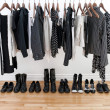 Black and white female clothes and shoes - Stock Photo