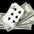 Deck of cards and money on black background — Stock Photo