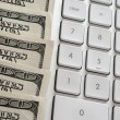 American dollars near computer keyboard calculator — Stock Photo