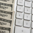 Stock Photo: American dollars near computer keyboard calculator