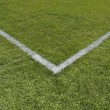 Painted lines in the corner of a playing field - Stock Photo