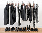 Black and white clothes for man and woman — 图库照片