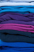 Folded blue, purple and indigo clothes — Stock Photo