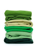 Pile of green folded clothes — Stock Photo