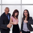 Multiethnic business team showing thumbs up — Stock Photo