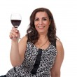 Smiling mature woman with a glass of wine — Stock Photo