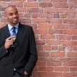 Smiling young business man drinking wine — Stock Photo #22275867