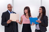 Young woman giving tasks to her colleagues — Stock Photo
