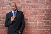 Smiling young business man drinking wine — Stock Photo