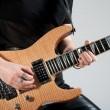 Female guitarist playing electric guitar - Stock Photo