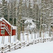 Little red house covered by snow — Stock Photo #22334957