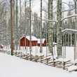 Stock Photo: Red wooden houses in snowy landscape