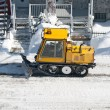 Stock Photo: City street cleaned from snow by a snowplough