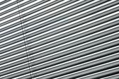 Semi-closed metallic blinds — Stock Photo