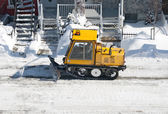 City street cleaned from snow by a snowplough — Stock Photo