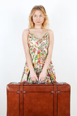Girl with vintage suitcase anticipating travel — Stock Photo