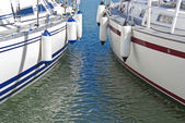 Colorful motorboats on calm water — Stock Photo