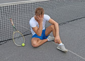 Lost game. Disappointed tennis player. — Стоковое фото