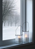 Cozy lanterns and winter landscape seen through the window — Stok fotoğraf