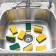 Lots of yellow sponges in a clean kitchen sink — Stock Photo