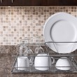 Stock Photo: Dish rack on kitchen countertop