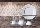Dish rack on kitchen countertop — Stok fotoğraf