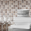 Stock Photo: White dishes and plates on kitchen countertop