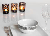 Table setting with three candles — Stock Photo