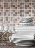 White dishes and plates on kitchen countertop — Stock Photo