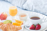Tasty breakfast in bed — Stock Photo