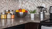Food ingredients and herbs on kitchen countertop — Stockfoto