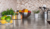 Kitchen countertop with food ingredients and herbs — ストック写真