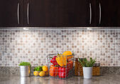 Vegetables, fruits and herbs in a kitchen with cozy lighting — Stock Photo