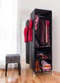 Mobile wardrobe with clothing and shoes — Stock Photo